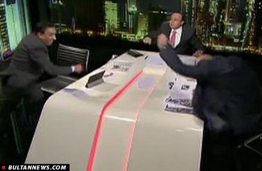 عامل وابسته به سعودی در میزگرد الجزیره بطری آب پرتاب کرد